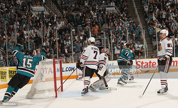 Brent Seabrook, Marian Hossa and Antti Niemi of the Chicago Blackhawks and Dany Heatley and Joe Thornton of the San Jose Sharks react to a goal in...