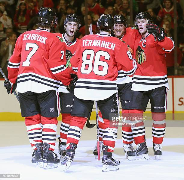 Brent Seabrook Niklas Hjalmarsson Marian Hossa and Jonathan Toews of the Chicago Blackhawks move to congratulate teammate Teuvo Teravainen after...
