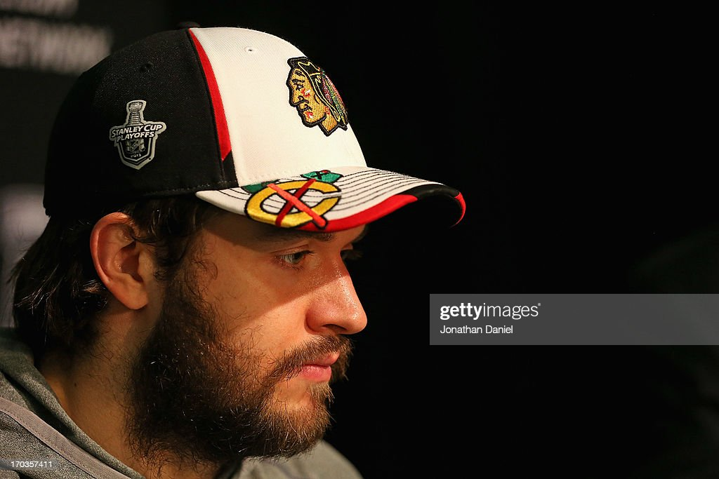 Brent Seabrook #7 of the Chicago Blackhawks answers questions during the 2013 NHL Stanley Cup media day at the United Center on June 11, 2013 in Chicago, Illinois.