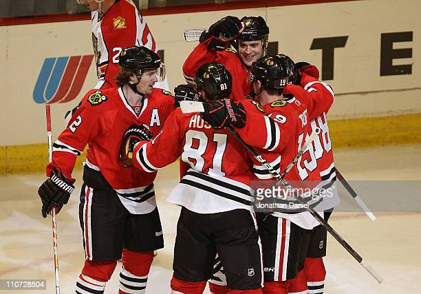 Brent Seabrook of the Chicago Blackhawks celebrates his 2nd period goal with teammates Duncan Keith Marian Hossa Jonathan Toews and Patrick Kane...
