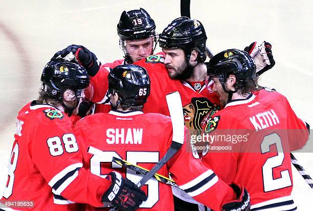 Brent Seabrook of the Chicago Blackhawks celebrates with his teammates after scoring a goal on Jonathan Quick of the Los Angeles Kings in the first...