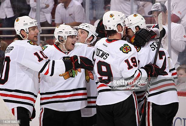 Brent Seabrook of the Chicago Blackhawks celebrates with Patrick Sharp, Patrick Kane and Jonathan Toews after Seabrook scored the game tying goal...