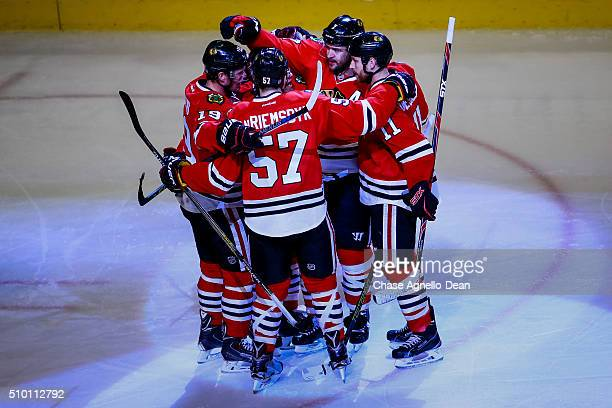 Brent Seabrook of the Chicago Blackhawks celebrates with teammates after scoring against the Anaheim Ducks in the third period of the NHL game at the...