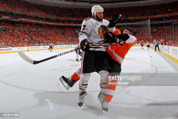 Brent Seabrook of the Chicago Blackhawks checks Arron Asham of the Philadelphia Flyers in Game Three of the 2010 NHL Stanley Cup Final at Wachovia...