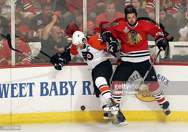 Brent Seabrook of the Chicago Blackhawks checks Mike Richards of the Philadelphia Flyers into the boards in the second period of Game One of the 2010...