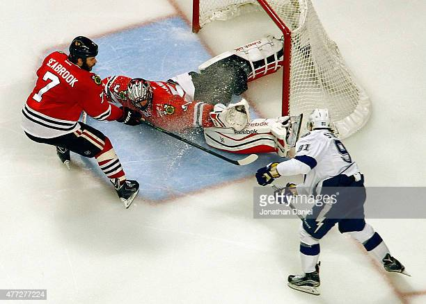 Brent Seabrook of the Chicago Blackhawks clears the puck after Corey Crawford of the Chicago Blackhawks makes a save against Steven Stamkos of the...