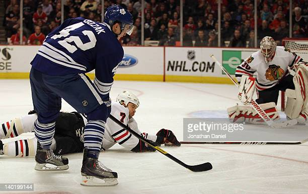 Brent Seabrook of the Chicago Blackhawks falls to ice to stop a shot against Ray Emery by Tyler Bozak of the Toronto Maple Leafs at the United Center...