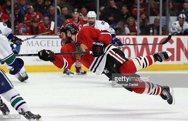 Brent Seabrook of the Chicago Blackhawks goes airbourne as he shots against the Vancouver Canucks at the United Center on February 11 2015 in Chicago...