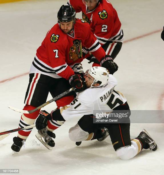 Brent Seabrook of the Chicago Blackhawks hits Kyle Palmieri of the Anaheim Ducks in the face at the United Center on February 12 2013 in Chicago...
