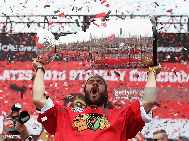 Brent Seabrook of the Chicago Blackhawks holds the Stanley Cup trophy during the Chicago Blackhawks Stanley Cup Championship Rally at Soldier Field...