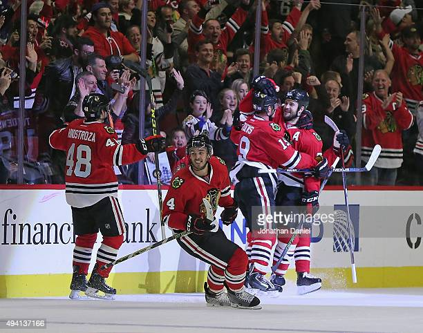 Brent Seabrook of the Chicago Blackhawks hugs teammate Jonathan Toews after Toews scored the gamewinning goal against the Tampa Bay Lightning as...