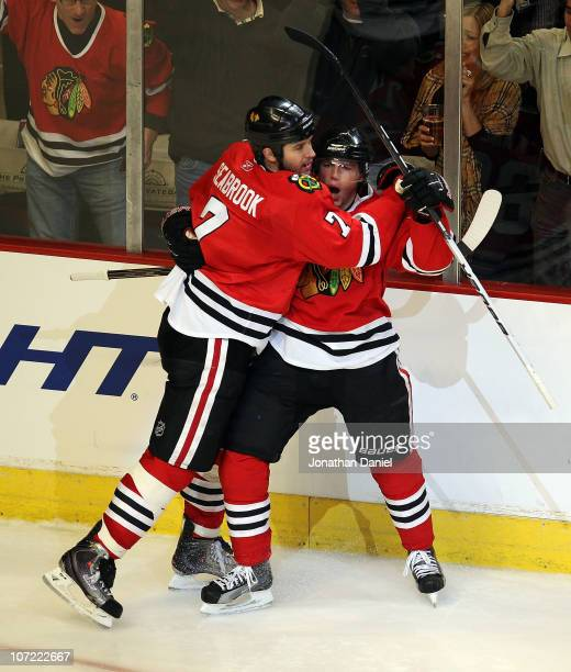 Brent Seabrook of the Chicago Blackhawks hugs teammate Patrick Kane after Kane scored his second goal of the game against the St. Louis Blues at the...