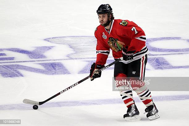 Brent Seabrook of the Chicago Blackhawks moves the puck while taking on the Philadelphia Flyers in Game Two of the 2010 NHL Stanley Cup Final at the...