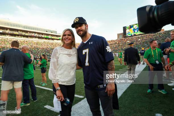 Brent Seabrook of the Chicago Blackhawks poses for a photo with Kathryn Tappen of NBC sports on the sidelines at Notre Dame Stadium on September 1...