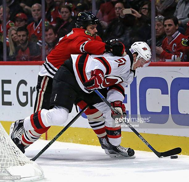 Brent Seabrook of the Chicago Blackhawks pressures Sergey Kalinin of the New Jersey Devils at the United Center on November 12 2015 in Chicago...