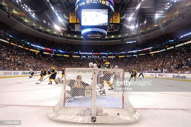 Brent Seabrook of the Chicago Blackhawks scores a game winning goal against Tuukka Rask of the Boston Bruins in overtime in Game Four of the 2013 NHL...