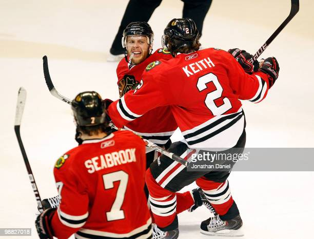 Brent Seabrook of the Chicago Blackhawks skates up as teammate Duncan Keith moves to hug Kris Versteeg after a 3rd period goal against the Vancouver...