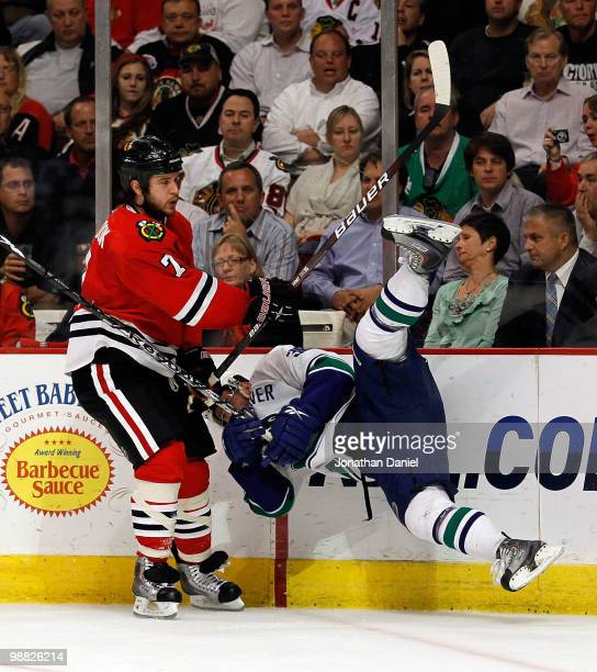 Brent Seabrook of the Chicago Blackhawks upends Jannik Hansen of the Vancouver Canucks in Game Two of the Western Conference Semifinals during the...