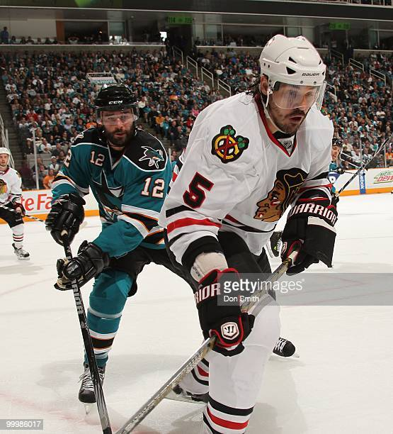 Brent Sopel of the Chicago Blackhawks battles with Patrick Marleau of the San Jose Sharks in Game One of the Western Conference Finals during the...