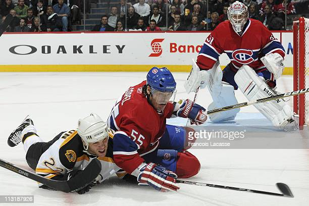 Brent Sopel of the Montreal Canadiens falls onto the ice with Shawn Thornton of the Boston Bruins in Game Three of the Eastern Conference...