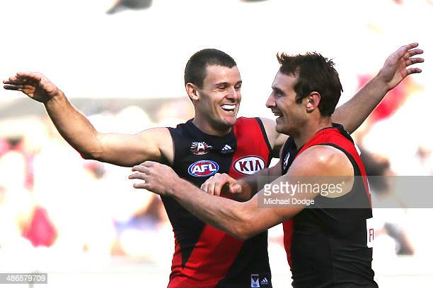 Brent Stanton of the Bombers celebrates a goal with Jobe Watson during the round six AFL match between the Collingwood Magpies and the Essesdon...