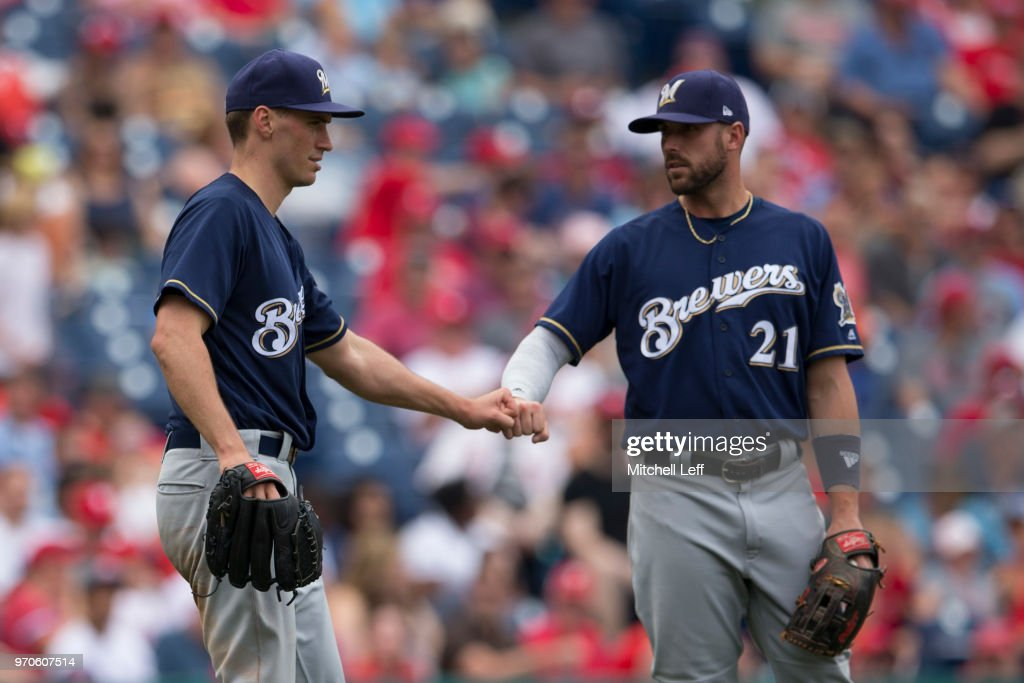 Brent Suter #35 of the Milwaukee Brewers fist bumps Travis Shaw #21 after recording an out in the bottom of the fifth inning against the Philadelphia Phillies at Citizens Bank Park on June 9, 2018 in Philadelphia, Pennsylvania. The Brewers defeated the Phillies 12-3.