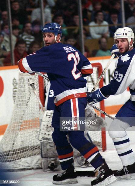 Brent Sutter of the New York Islanders skates against the Toronto Maple Leafs during NHL game action On December 26 1988 at Maple Leaf Gardens in...