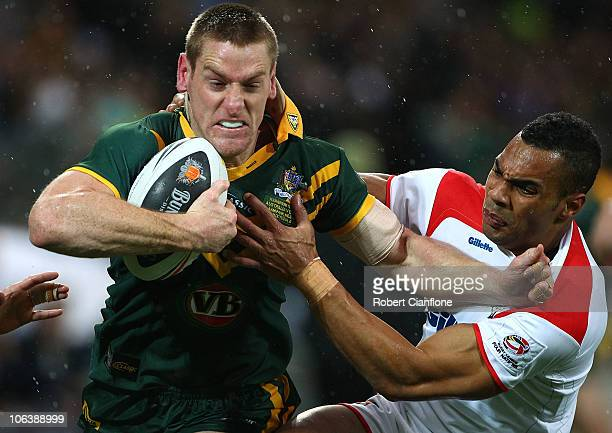 Brent Tate of Australia gets away from Ryan Atkins of England during the Four Nations match between the Australian Kangaroos and England at AMMI Park...