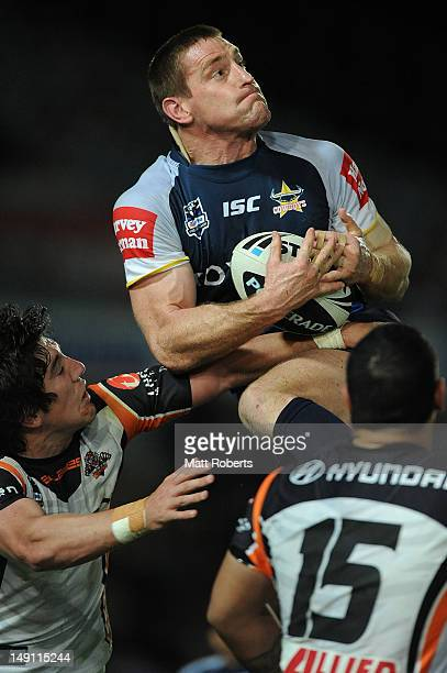 Brent Tate of the Cowboys catches the ball during the round 20 NRL match between the North Queensland Cowboys and the Wests Tigers at Dairy Farmers...