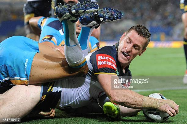 Brent Tate of the Cowboys scores a try which is later denied by the video referee during the round four NRL match between the Gold Coast Titans and...
