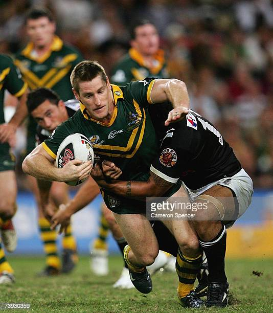 Brent Tate of the Kangaroos is tackled during the ARL Bundaberg Test match between the Australian Kanagroos and the New Zealand Kiwis at Suncorp...