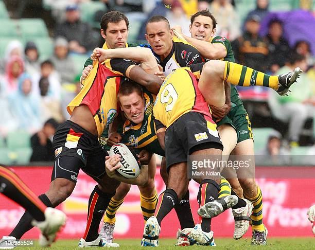 Brent Tate of the Kangaroos is tackled during the Four Nations match between the Australian Kangaroos and Papua New Guinea at Parramatta Stadium on...