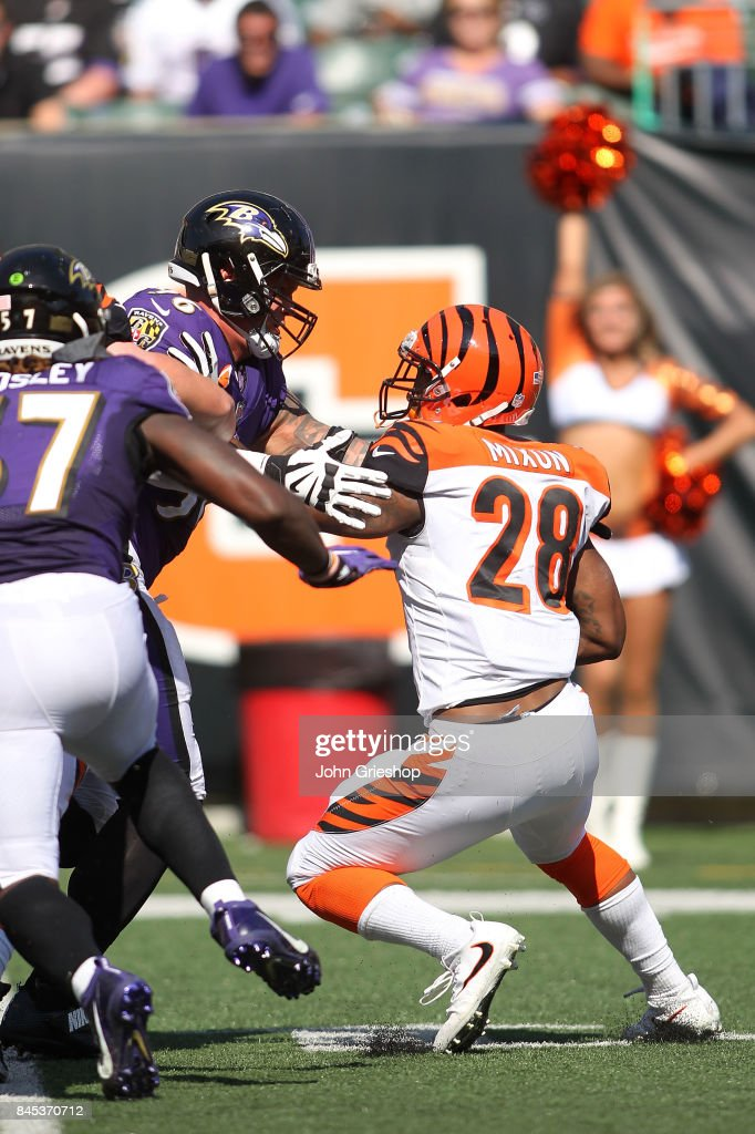 Brent Urban #96 of the Baltimore Ravens tackles Joe Mixon #28 of the Cincinnati Bengals during the fourth quarter at Paul Brown Stadium on September 10, 2017 in Cincinnati, Ohio. Baltimore defeated Cincinnati 20-0.
