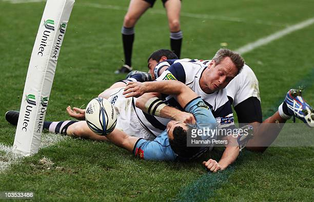 Brent Ward of Auckland tackles Iwi Hauraki of Northland out over the sideline during the round four ITM Cup match between Auckland and Northland at...