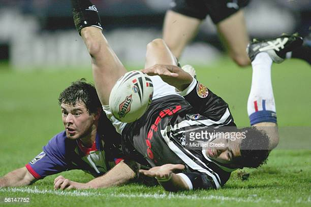 Brent Webb of New Zealand loses the ball as Paul Wellens prevents a try during the Gillette Tri Nations match between Great Britain and New Zealand...