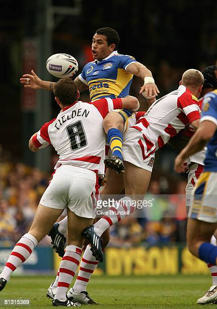 Brent Webb of the Leeds Rhinos in action with Stuart Fielden of Wigan Warriors during the Carnegie Challenge Cup match between Leeds Rhinos and Wigan...