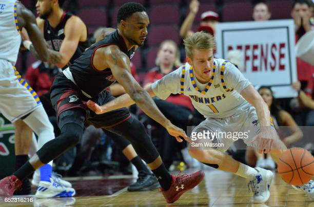 Brent Wrapp of the Cal State Bakersfield Roadrunners and Ian Baker of the New Mexico State Aggies fight for a loose ball during the championship game...