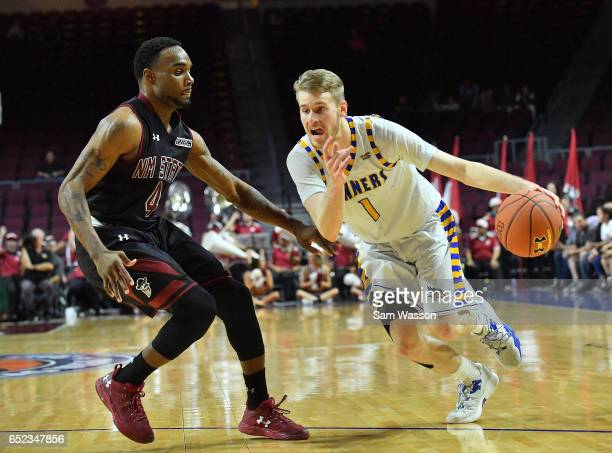 Brent Wrapp of the Cal State Bakersfield Roadrunners drives against Ian Baker of the New Mexico State Aggies during the championship game of the...