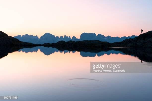 brenta dolomites reflected in lago nero di cornisello, italy - マドンナディカンピリオ ストックフォトと画像
