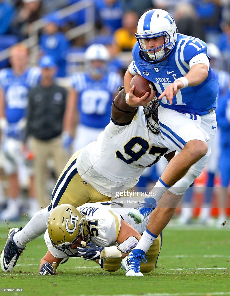 Brentavious Glanton #97 and Brant Mitchell #51 of the Georgia Tech Yellow Jackets tackle Daniel Jones #17 of the Duke Blue Devils during their game at Wallace Wade Stadium on November 18, 2017 in Durham, North Carolina. Duke won 43-20.