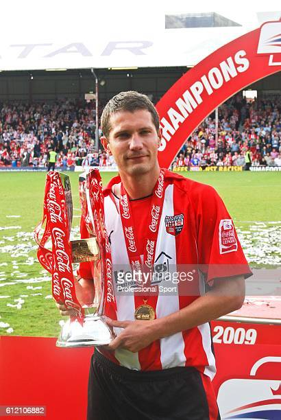 Brentford captain Kevin O'Connor holding the trophy after winning the League Two Championship following the Coca-Cola League Two match between...