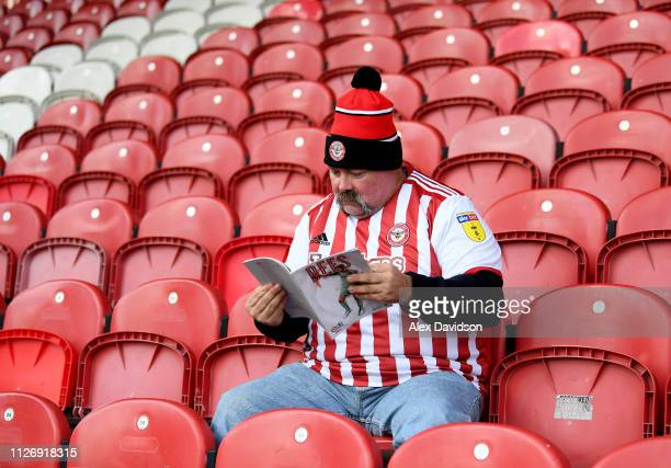 Brentford fan reads the match program prior to the Sky Bet Championship match between Brentford and Blackburn Rovers at Griffin Park on February 02...