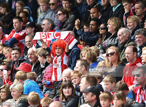 Brentford fan supports his team during the Sky Bet Championship match between Brentford and Wigan Athletic at Griffin Park on May 2 2015 in Brentford...