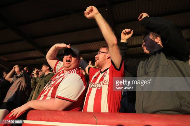 Brentford fans celebrate during the Sky Bet Championship match between Brentford and Hull City at Griffin Park on February 23 2019 in Brentford...