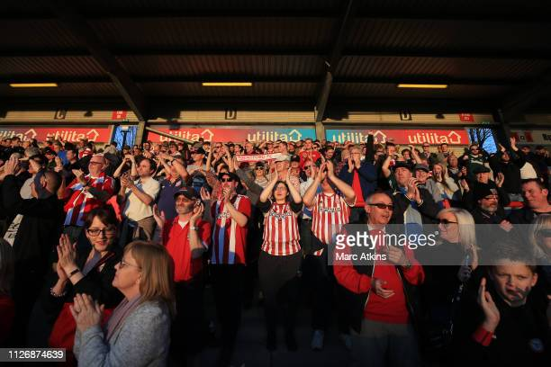 Brentford fans celebrate the win during the Sky Bet Championship match between Brentford and Hull City at Griffin Park on February 23 2019 in...