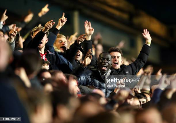 Brentford fans celebrate their first goal during the Sky Bet Championship match between Queens Park Rangers and Brentford at The Kiyan Prince...