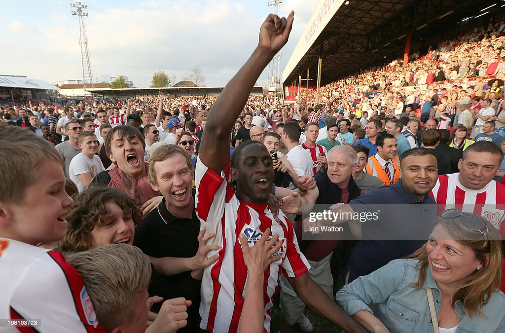 Brentford fans celebrates with Clayton Donaldson after the npower League One Play Off Semi Final, Second Leg match between Brentford and Swindon at Griffin Park on May 5, 2013 in London, England.