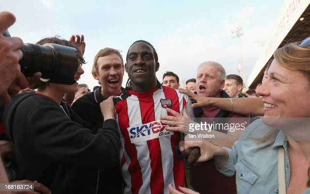 Brentford fans celebrates with Clayton Donaldson after the npower League One Play Off Semi Final Second Leg match between Brentford and Swindon at...