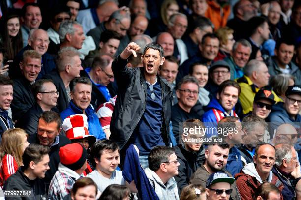 Brentford fans] gestures during the Sky Bet Championship match between Brentford and Blackburn Rovers at Griffin Park on May 7 2017 in Brentford...