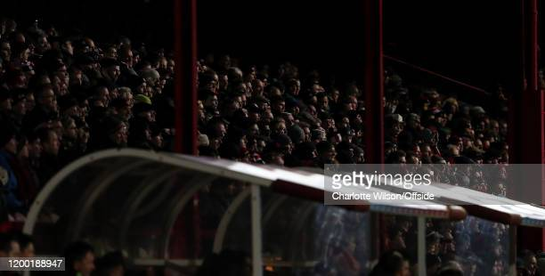 Brentford fans in eerie light at Griffin Park during the Sky Bet Championship match between Brentford and Leeds United at Griffin Park on February 11...